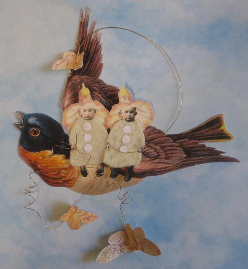 Babies on bird ornament