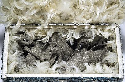 Box_of_silver_swan_spare_parts_and_